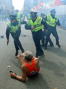 This runner has just been knocked over by the blast; these police are there immediately, running headlong into the smoke. May we all be so courageous.