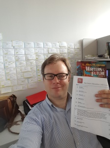 Me in my office. Note that the Writers of the Future Anthology is #7 on the Publisher's Weekly Bestseller's list for SF/F.